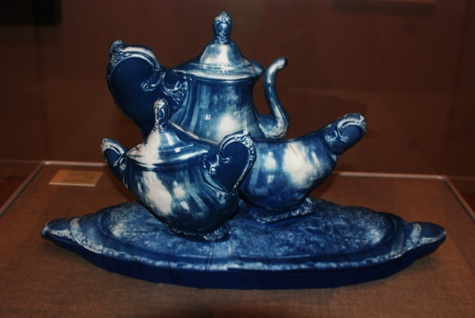 "Stuffed three dimensional fabric tea set by Catherine Jansen. ""I photographed the tea set, blew up the negative to life size, made a cyanotype photogram on a piece of cloth, the stitched it together and stuffed it."" Shared under a Creative Commons Attribution-Share Alike 2.0 Generic"