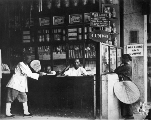 A shop in China, rather than a china shop, but either way, no bulls in sight. Photo from 'Through China with a Camera' 中文(繁體)‎: 位於香港的中國古玩店。 Date 1868~1872  By John Thomson {{PD}}