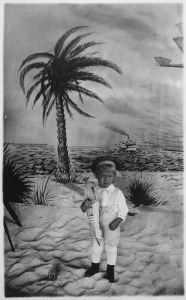 This is a childhood photo of US President Gerald Ford. Note that, though there's water in the background, the boat is on dry land {{PD}}