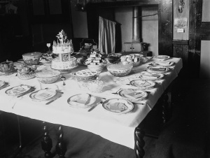 Table set for a birthday party, probably 1940s Wales. Source of the file: http://www.llgc.org.uk/en/ CC0 1.0 Universal Public Domain Dedication