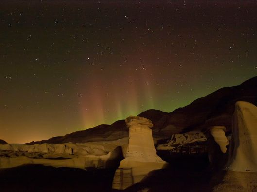 'Hoodoos and aurora in Drumheller, Alberta' Photo by Keith E. Doucet CC BY-SA 3.0 Via Wikimedia Commons