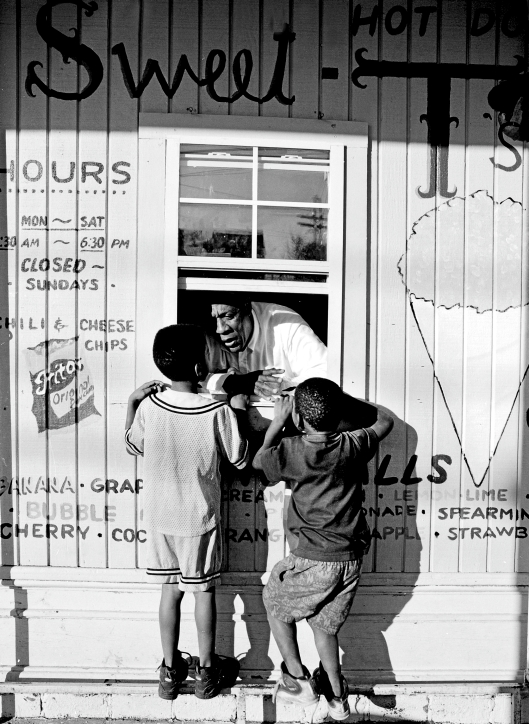 """Kids order sno-balls, the New Orleans, Louisiana, version of what others call sno-cone flavored ices"" Photo by Carol M. Highsmith via the Library of Congress--no known restrictions"