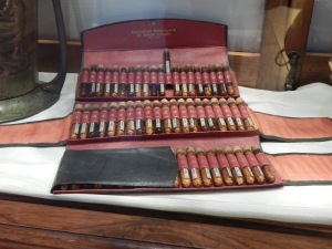 Pharmacists's set with pill tubes in the Hash, Marijuana & Hemp Museum, Amsterdam. Photo by Lord Toran CC0