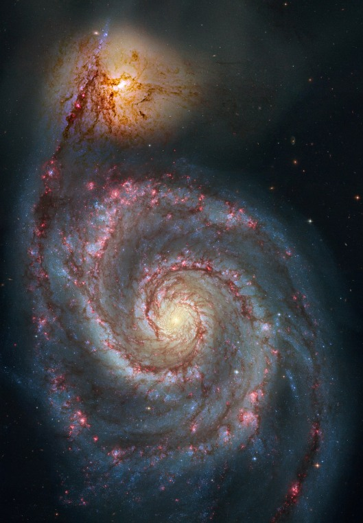 NGC 5194 Over 60,000 light-years across, M51's spiral arms and dust lanes clearly sweep in front of its companion galaxy (top), NGC 5195. Image data from the Hubble's Advanced Camera for Surveys has been reprocessed to produce this alternative portrait of the well-known interacting galaxy pair. They about 31 million light-years distant. Not far from the handle of the Big Dipper, they officially lie within the boundaries of the constellation Canes Venatici NASA {{PD}}